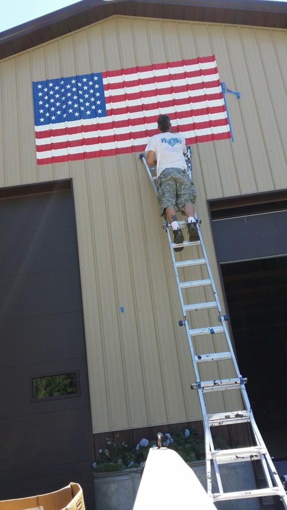 hand painted armerican flag on corrugated aluminum pull barn