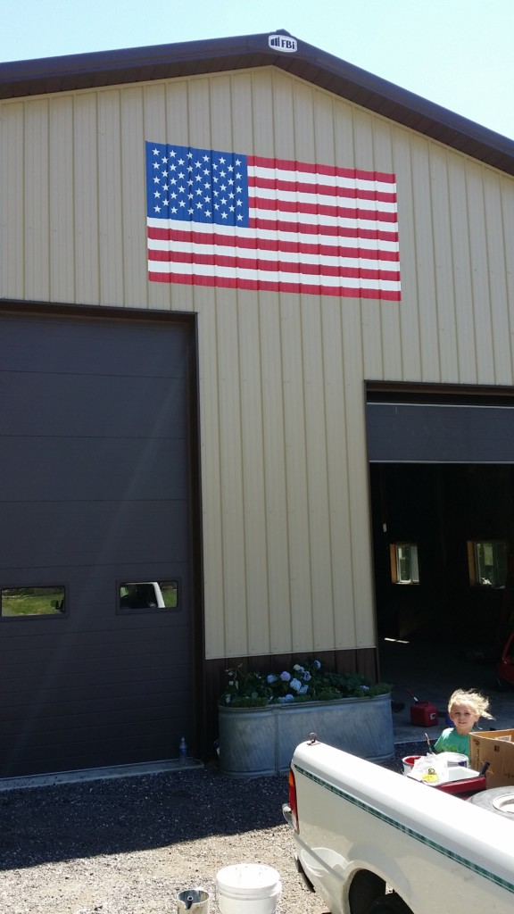 hand painted armerican flag on corrugated aluminum pull barn