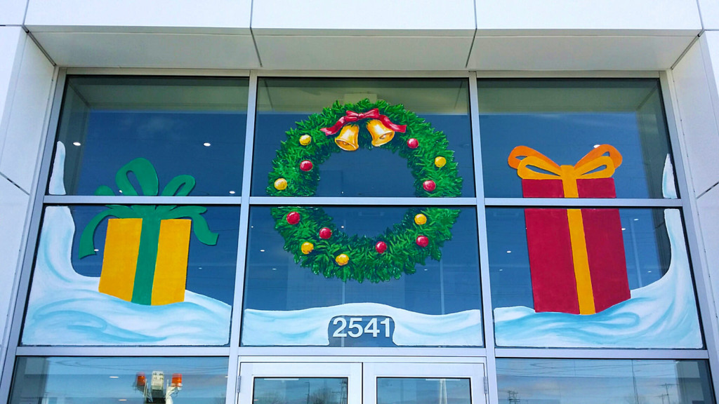 christmas window painting wreath and presents springfield illinois