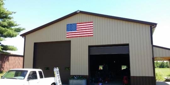 american flag on corrugated alumnium pull barn