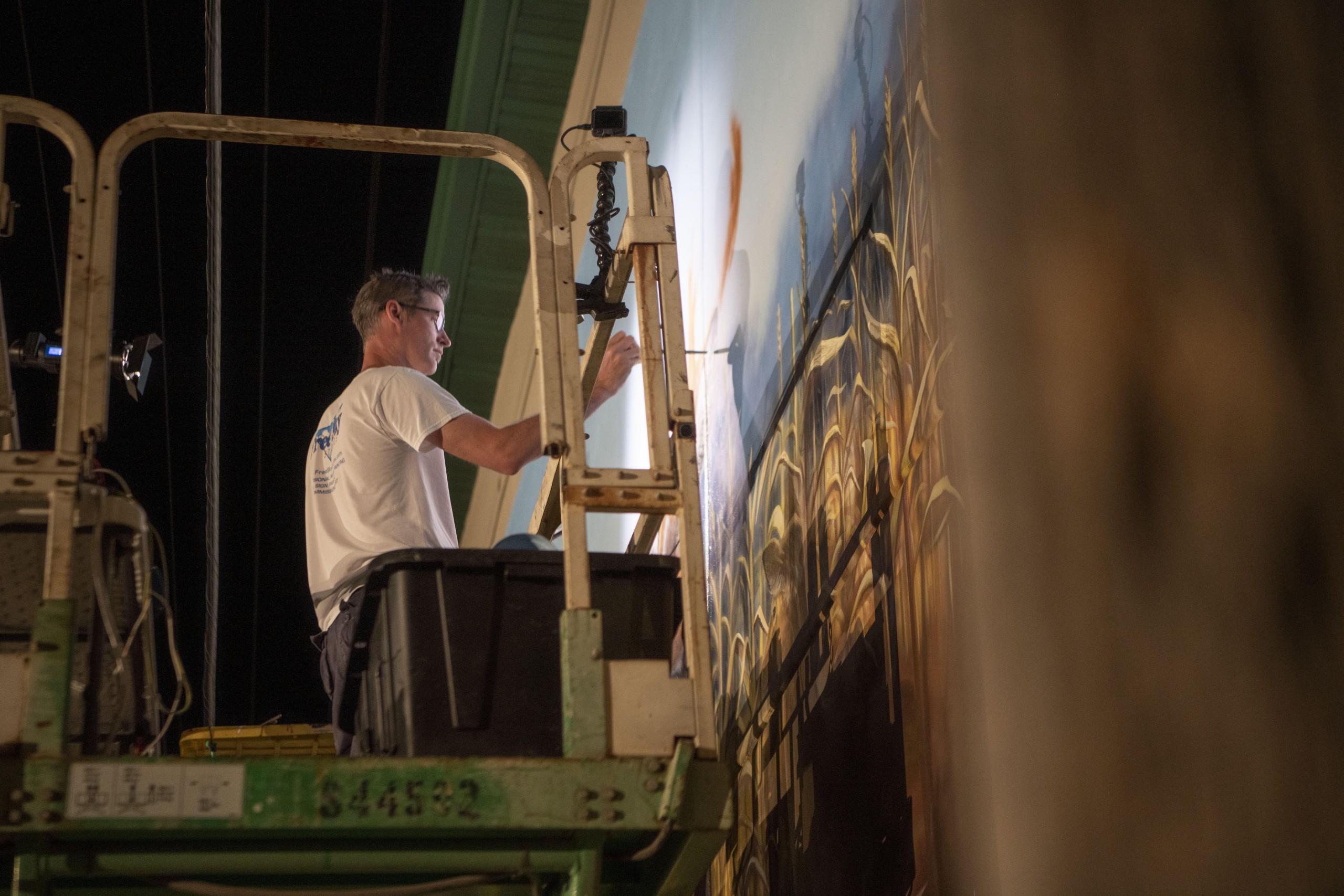 mural artist Troy Freemanwhitetail properties mural painting